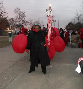 Detroit Alum 1st VP Marcia Jackson holds high the National Delta Torch!