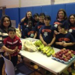 Christina Guzman and Rosa Barajas providing participants with their daily snack.
